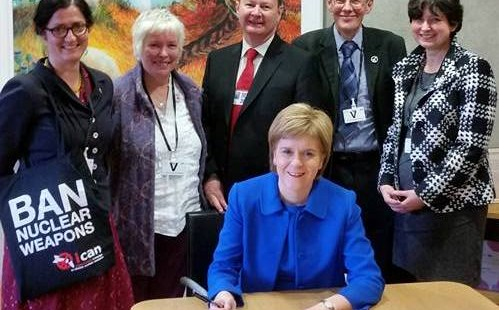 Sturgeon signing ICAN pledge - cropped